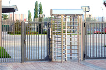 Protected Entrance Gate.Entrance To Office Through Big In Full Human Growth Stainless Steel Turnstiles. Concept Of Security, Lock, Gates, Business, Dangerous.