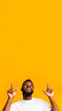 Happy Excited African American Man Pointing At Empty Space