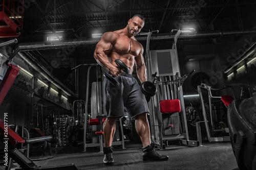 Canvastavla  Brutal strong athletic men pumping up muscles workout bodybuilding concept backg
