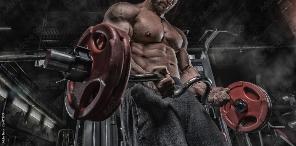 Fototapety, obrazy: Sexy muscular man in gym, shaped abdominal. Strong male naked torso abs, working out. Dark background.