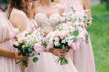 Bridesmaid's Bouquets, Wedding Bouquets Close Up. Stylish Wedding. Contemporary Fashion Wedding Trends. Elegant Beautiful Style. Modern Wedding Concept. Bridesmaids Holding Wedding Bouquets Outdoor.