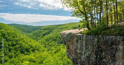 Tourist visitors couple taking pictures at Whitaker Point rock cliff hiking trai Canvas Print