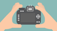 Taking A Photo Concept. Hands Holding A Digital Camera