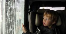 Little Boy Looking Through Mis...