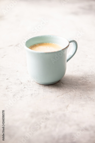 Tuinposter Europa A cup of coffee on light grey background