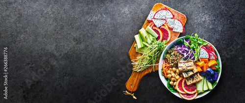colorful buddha bowl with panoramic copy space composition