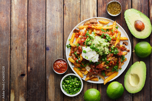 Fotografia, Obraz mexican carne asada fries in copy space composition shot from birds eye view