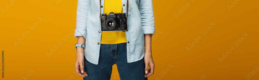Fototapety, obrazy: panoramic shot of young woman standing with digital camera on orange