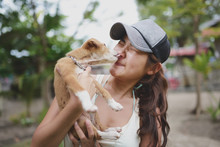 Woman Being Licked By A Puppy