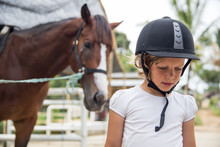 Young Girl At The Horse Stable
