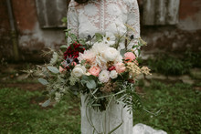 Bride Holding Large Pink And White Flower Bouquet On Wedding Day