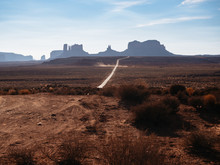 Long Lonely Road Through Monument Valley In The Southwestern United States.