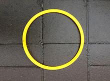 Yellow Circle On Pavement