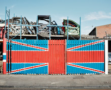 The Union Jack Flag On The Wall Of A Scrap Yard