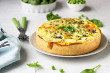 Spinach And Green Pea Quiche, Tart Or Pie With Fresh Ingredients For Baking. Light Grey Background, Copy Space.