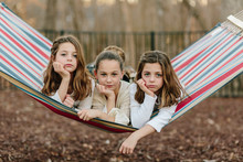 Three Sister Laying In A Hammock Together