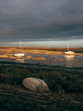 Low Tide And Boats At Sunset. Wells-next-the-sea, Norfolk, UK.