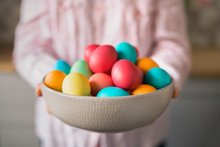 Woman Holding Bowl Full Of Easter Eggs