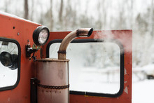 Dirty Pollution Exhaust Spews From Muffler Of Old Vintage Snow Grooming Machine