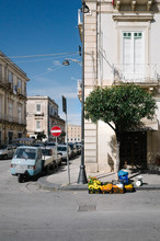 Italian Street Corner With Vegetable Stand And Vintage Scooter