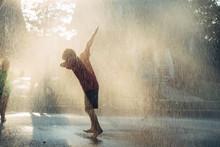 Kid Having Fun In Rain