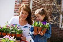 Gardening: Parent And Child Ready To Plant Flowers