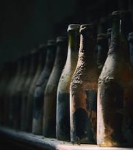 Old Wine Bottles In Row
