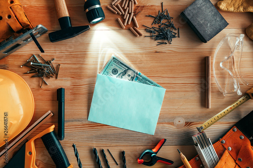 Poster Fleur Money in envelope on carpentry woodwork workshop desk
