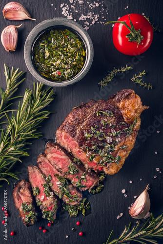 Juicy tender sous-vide grilled irish beef rump steak with fresh herbs Wall mural