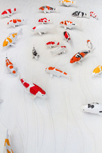 Carps Fish Or Koi Fish Statue On Cement Wall For Decorate, Stucco Handcraft Of Koi Carp Fish On The Wall