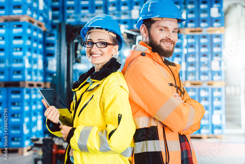 Worker woman and man in warehouse Tablou Canvas