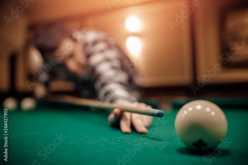 Stampa su Tela Russian billiards, man plays and beats cue on white ball