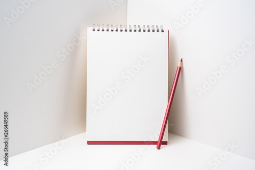 Fotografie, Obraz  red spiral notebook with white page on 3D space