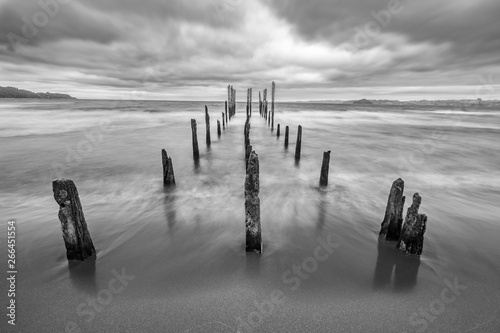 фотография Like a highway to hell an old pier inside the lake waters under a dramatic overcast sky and high winds