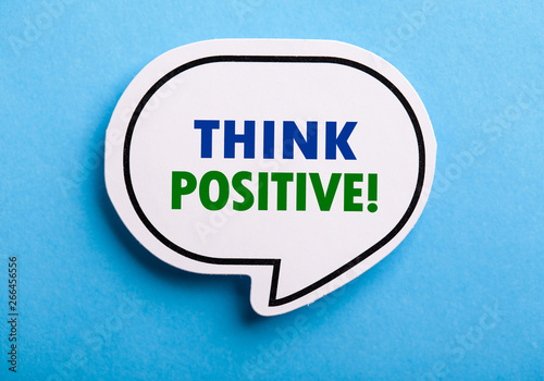 Photo  Think Positive Speech Bubble Isolated On Blue Background