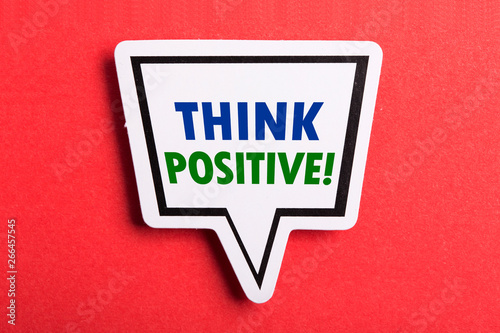 Photo  Think Positive Speech Bubble Isolated On Red Background
