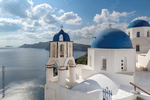 Foto auf Gartenposter Santorini Santorini, Greece. Greek orthodox church with blue domes and sea in Oia town, Santorini island, Greece.