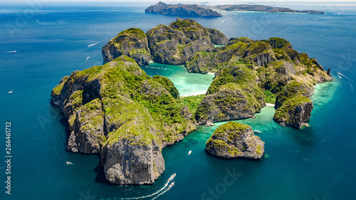 Foto auf Leinwand Blau türkis Aerial drone view of tropical Ko Phi Phi island, beaches and boats in blue clear Andaman sea water from above, beautiful archipelago islands of Krabi, Thailand
