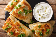 Bolani Is A Traditional Afghani Flatbread Stuffed And Baked With Either Potato, Onion, Cilantro Filling Closeup. Horizontal Top View
