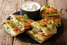 Rustic Style Afghan Fried Flatbread Bolani Stuffed With Potatoes, Green Onions And Cilantro Close-up. Horizontal