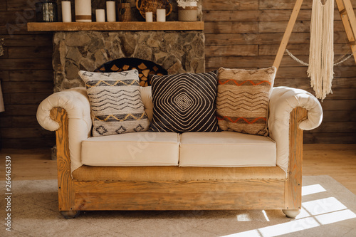 Wooden Sofa in Chalet Cozy Interior with Fireplace. Rustic ...