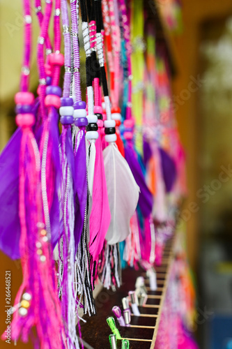Spoed Fotobehang Carnaval colored feathers of Indians in the storefront. Copy space,