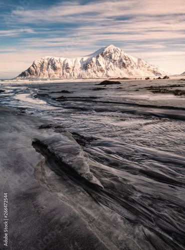 Snowy mountain on striped sand on coastline at Skagsanden beach Fototapete
