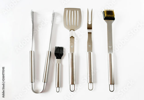 Fotografía  Top view object set of BBQ equipment stainless steel as tongs, carving fork, spatula in black bag