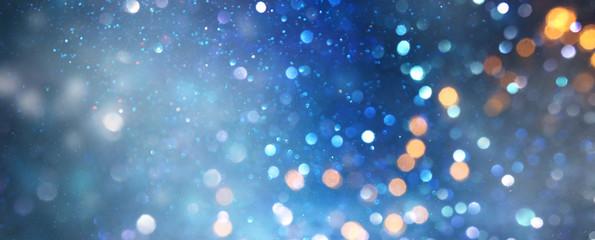 glitter vintage lights background. black silver and blue. de-focused