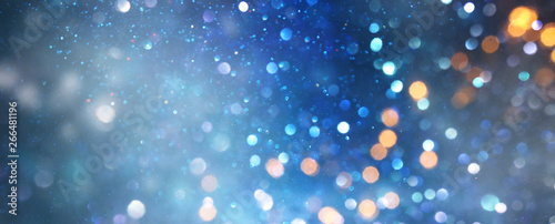 glitter vintage lights background. black silver and blue. de-focused