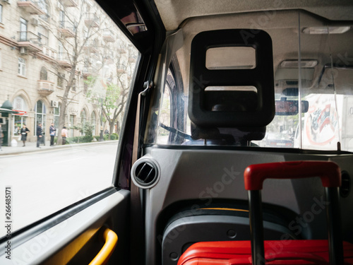 Fotografie, Obraz  Defocused view from hackney carriage taxi cab in Baku Azerbaijan with red luggag