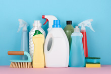 Cleaning Supplies On Pastel Ba...