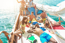 Happy Friends Having Fun In Summer Boat Party With Dj Mixing Music - Young Trendy People Enjoying Holiday On Sail Ship Tour - Travel And Friendship Concept - Focus On Bottom Guys