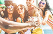 canvas print picture - Happy friends cheering with champagne in summer boat party - Young people having fun drinking and laughing together - Youth lifestyle and vacation concept - Focus on left black hand